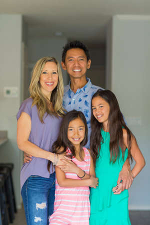 Portrait of a happy mixed race family. 写真素材
