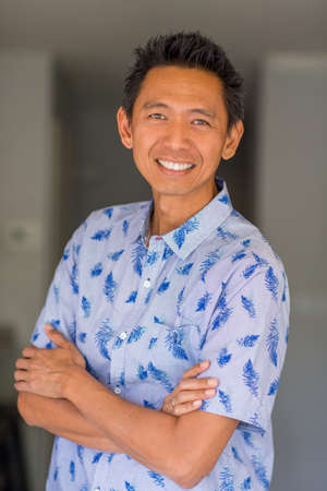Portrait of a mid adult Asian male.