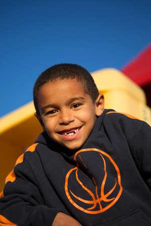 Cute little boy on a slide.