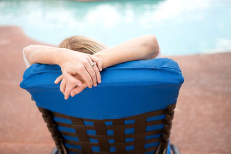 Woman relaxing on vacation by the pool. 写真素材