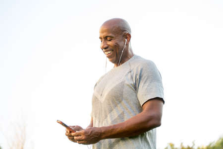 Fit African American man listening to music. Stock Photo