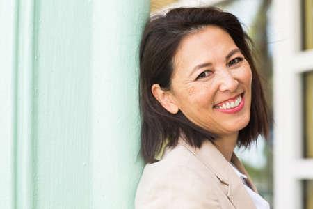 Portrait of a confident Asian businesswoman smiling.