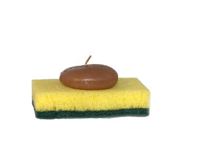 perfumed candle: isolated photo of a sponge with a candle