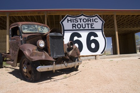 route 66: Old car in the famous route 66 road in USA Stock Photo