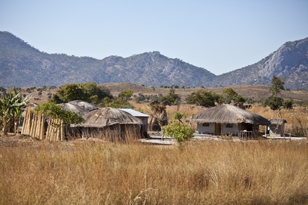 View of  an African village with small huts Stock Photo