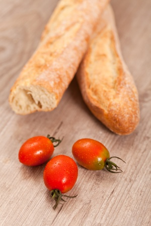 Crusty baguette bread and fresh tomatoes Stock Photo - 10710762