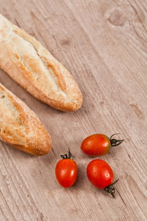 crusty: Crusty baguette bread and fresh tomatoes