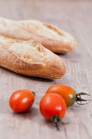 Crusty baguette bread and fresh tomatoes photo