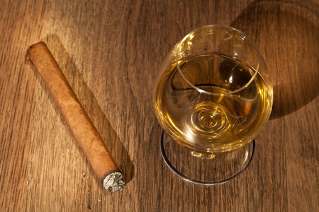 typical havana cigars with pure whisky drink background Stock Photo - 10777898