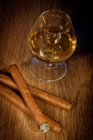 typical havana cigars with pure whisky drink background Stock Photo - 10777953