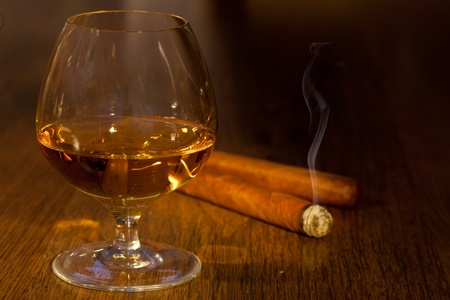 typical havana cigars with pure whisky drink background