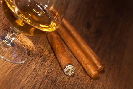 typical havana cigars with pure whisky drink background Stock Photo - 10778004