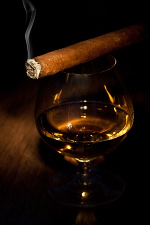 unhealthy lifestyle: typical havana cigars with pure whiskey drink background Stock Photo