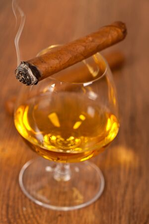 typical havana cigars with pure whisky drink background photo