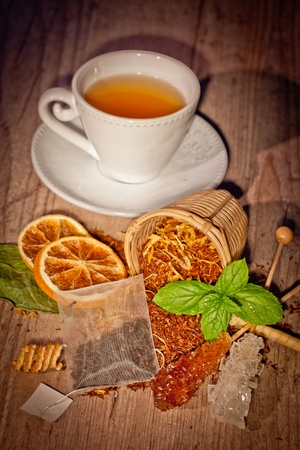 tea time set with flavors on wooden background photo