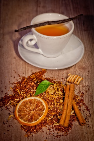 english breakfast tea: tea time set with flavors on wooden background