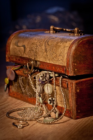 Vintage treasure chest with some jewels inside photo