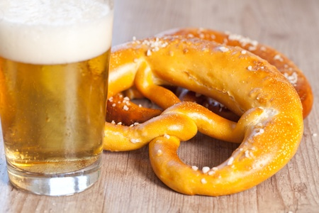 Typical crusty german pretzel bread with beer photo