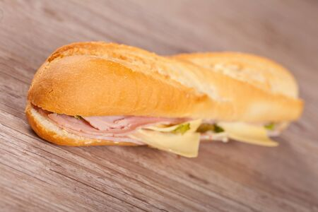 Tasty delicious sandwich with ham and cheese photo