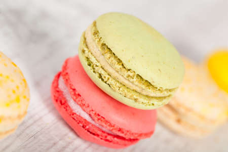 Colorful delicious macarons, typical french pastries Stock Photo - 11021399