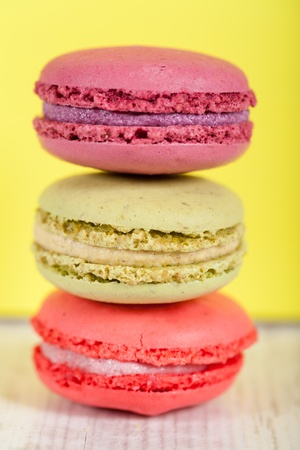 Colorful delicious macarons, typical french pastries Фото со стока