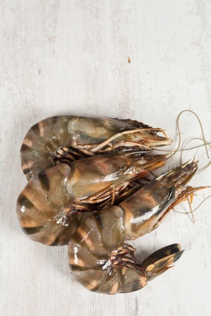 gambas: Fresh raw big prawn on wooden background