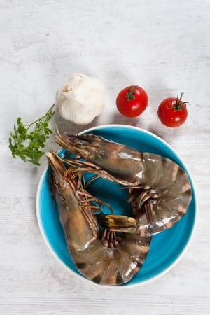 gambas: Fresh raw big prawns on a blue plate