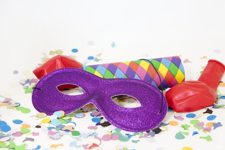Colorful carnival background with stripes and mask photo