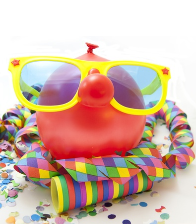 Colorful carnival background with balloon, stripes and mask