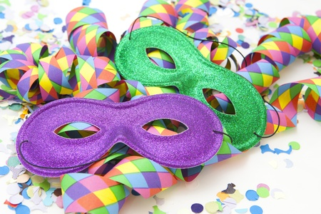 Colorful carnival background with stripes and mask Standard-Bild