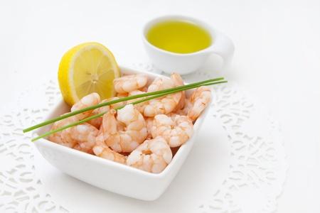 shrimp cocktail: food background with fresh shrimps and lemon Stock Photo