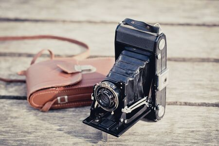 folding camera: Vintage photo of an old folding camera Stock Photo