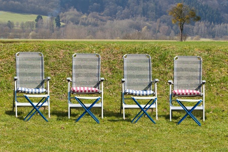 pic nic: Relaxing chairs on a sunny day in the countryside Stock Photo