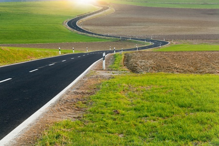 Winding long road in the beautiful countryside
