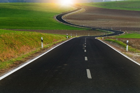 asphalt road: Winding long road in the beautiful countryside