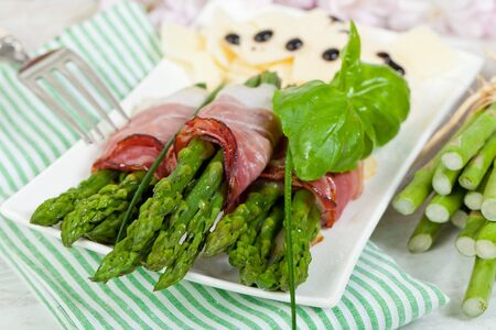 Delicious bunch of asparagus rolled with speck photo