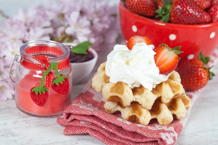 Delicious waffle with whipped cream and strawberries photo