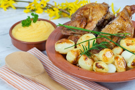 Tasty chicken with roasted potatoes photo