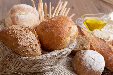 Crusty fresh bread assortment background