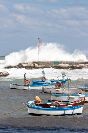 Small boats and a stormy sea in south of italy Stock Photo - 13155377