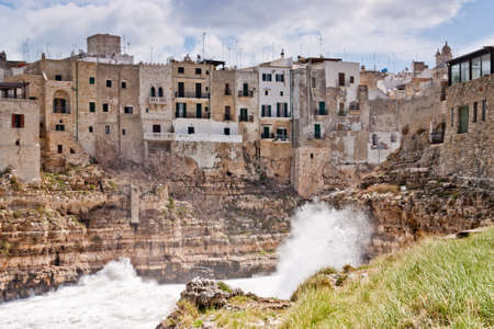 wonderfull: Sea storm over the wonderfull village of Polignano in south of italy Stock Photo