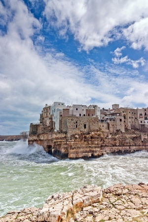 Sea storm over the wonderfull village of Polignano in south of italy Stock Photo - 13150059