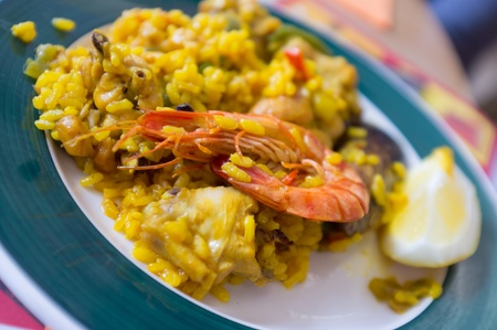 Delicious typical dish of spanish paella with seafood and vegetables photo