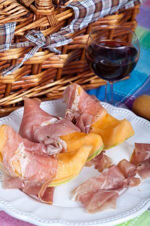 parma ham: Fresh cantaloupe melon with italian Parma ham