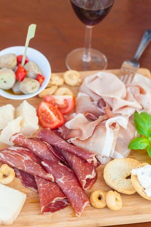 aperitive: Tasty assortment of fresh italian food on a chopping board Stock Photo