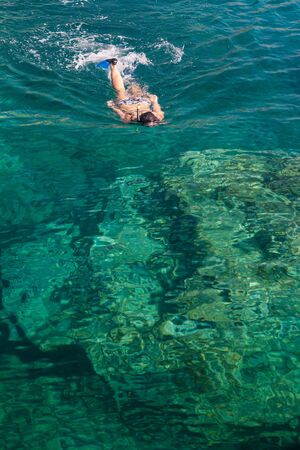snorkling: Swimming in a clear transparent water in Apulia region