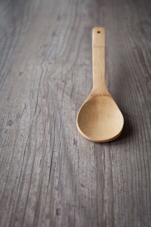 wooden spoon: Empty wooden spoon on a wooden background