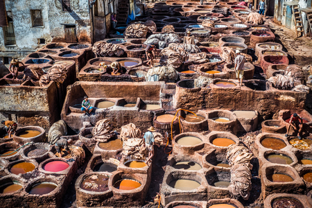 Tanners working leather in the old tannery of Fes, Morocco Stock Photo