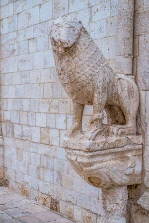 conversano: Stone lions on the portal of the mother church in Conversano, Italy Stock Photo