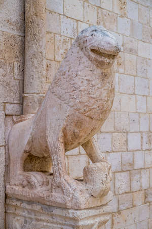 conversano: Stone lions on the portal of the mother church in Conversano, Italy Stock Photo